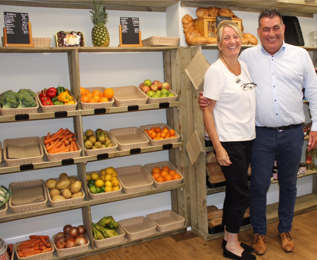 man-woman-in-shop-middleton-hall-retirement-village-farmhouse-shop-fruits-vegetables