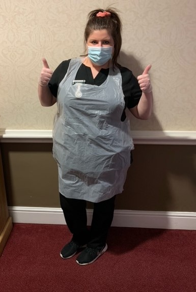 Carer Zoe gives a thumbs up to having the Covid vaccine