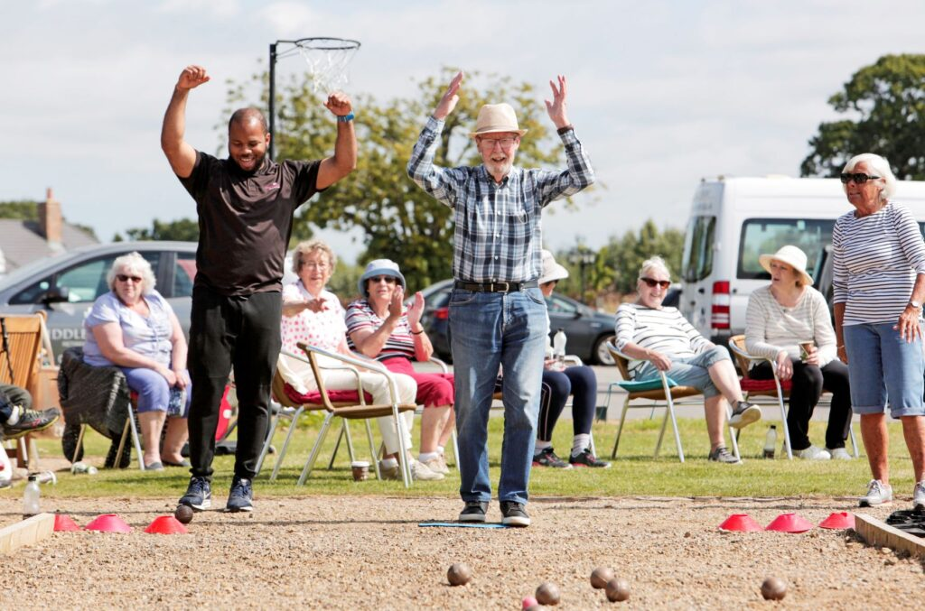 people cheering playing boules at sports day event 2021